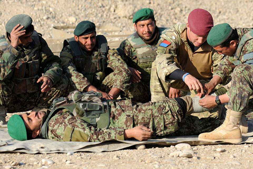A British Army medic trains Afghan soldiers to apply field dressings