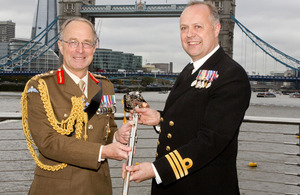 Chief of Defence Staff General Sir David Richards presents the Firmin Sword of Peace to Commander Steve Tatham Royal Navy on behalf of 15 (UK) Psychological Operations Group who have received the award in recognition of their work in Afghanistan