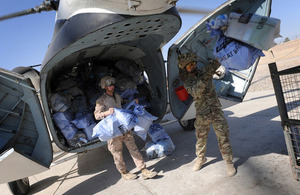 Troops unload bags of Christmas mail from the UK at Camp Bastion, Afghanistan (library image) [Picture: Corporal Mike O'Neill, Crown copyright]