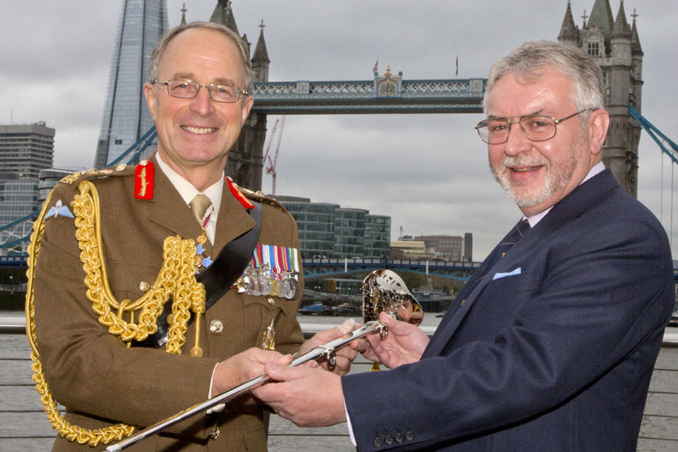 Chief of Defence Staff General Sir David Richards accepts the Firmin Sword of Peace from Mr Tony Kelly of Firmin and Sons