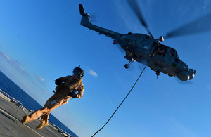 HMS Monmouth's boarding team practise fast roping from a Lynx Mk8 helicopter from 815 Naval Air Squadron