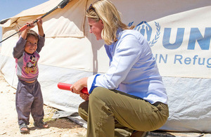 Photograph of Development Secretary Justine Greening and Syrian refugee