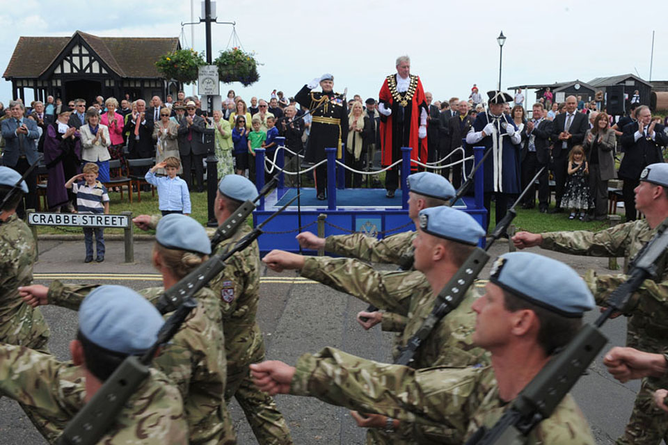 The Mayor of Aldeburgh, Councillor Peter Cox, and Lieutenant General Sir Gary Coward take the salute as soldiers from 3 Regiment Army Air Corps march through the town of Aldeburgh
