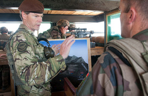 Lieutenant General Adrian Bradshaw talks about security in Tagab Valley with a French Army serviceman, in a guard tower at Forward Operating Base Tagab, Afghanistan