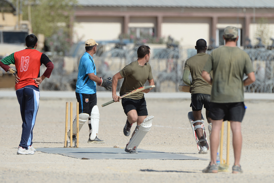 A member of the British Army side runs for the far wicket