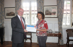 Ambassador Greg Dorey handing over certificate for 2013/14 Chevening scholar.