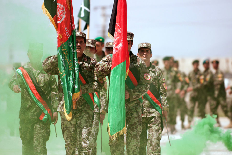 An Afghan National Army honour guard leads a parade formation of newly-graduated non-commisioned officers during a ceremony at Camp Ghazi, Kabul, Afghanistan