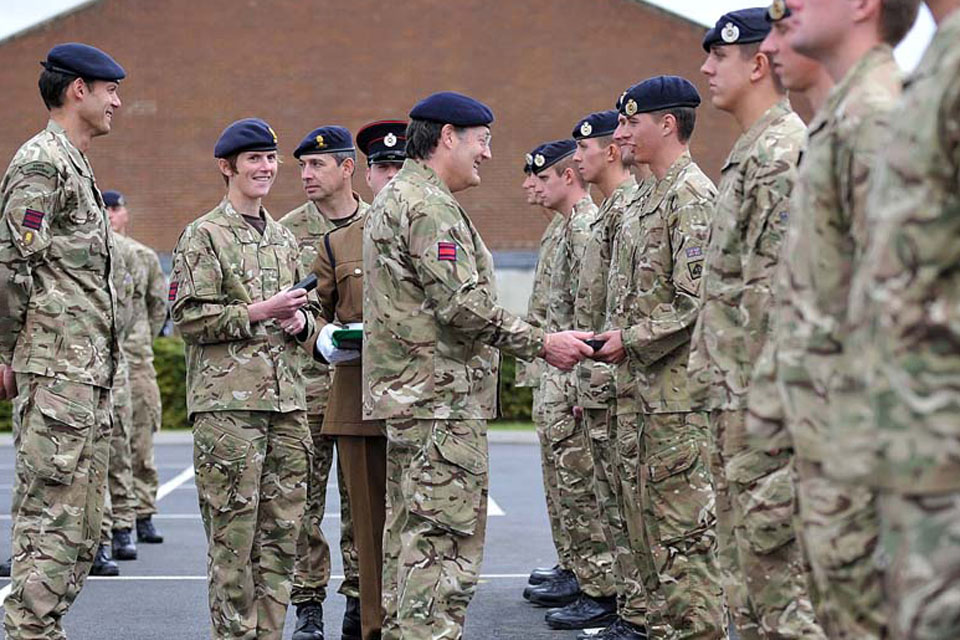 Lieutenant General Sir Mark Mans presents campaign medals to members of 26 Engineer Regiment