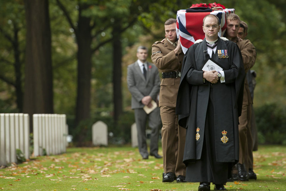 Reverend Mike Thomason, the padre of 5th Battalion The Rifles, leads the cortege of Private Lewis Curtis through the Arnhem Oosterbeek Cemetery in the Netherlands