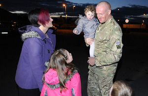 Sapper Ciaran Tannay is reunited with his family at Perham Down [Picture: Shane Wilkinson, Crown Copyright/MOD 2012]