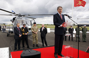 Defence Secretary Philip Hammond officially receives the first AW159 Wildcat helicopters from AgustaWestland on behalf of the Armed Forces at the Farnborough International Airshow