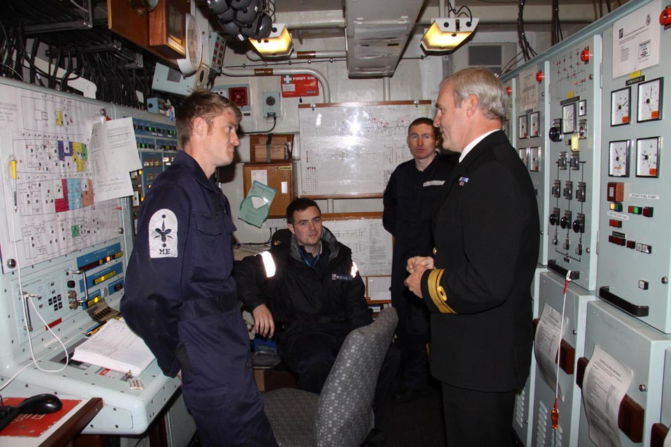 Vice Admiral Ian Corder talks with a seaman