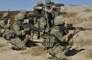 Members of Lima Company, 42 Commando Royal Marines, conducting section attack drills as part of their training package
