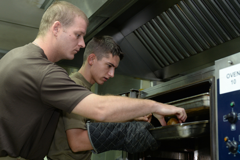 Army chef cooks under instruction