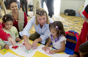 Justine Greening with Syrian refugee children. Picture: Scott Hornby/The Sun