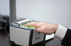 Image of person submitting biometric information.