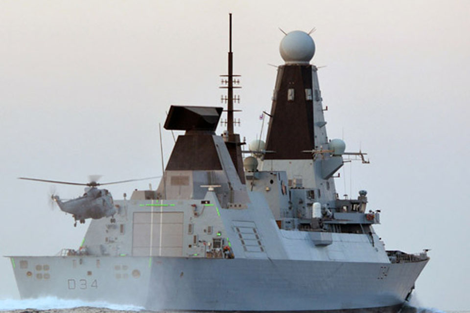 Green LED lights illuminate HMS Diamond's hangar structure to guide the helicopter in to land