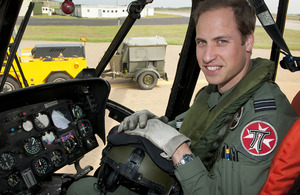 Flight Lieutenant William Wales in the cockpit of a Royal Air Force Sea King helicopter