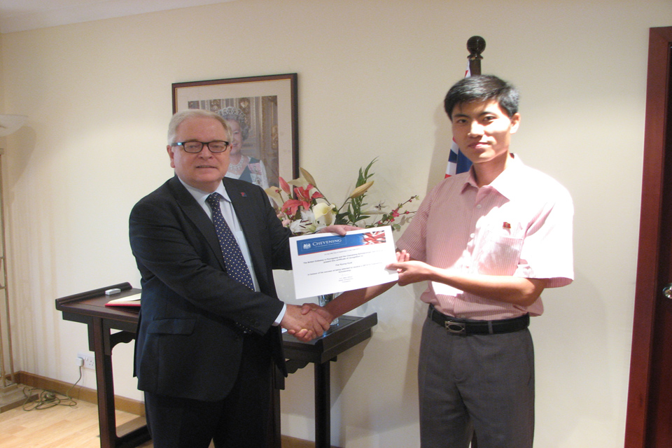 British Ambassador Mike Gifford congratulates Pae Ryong Hyok