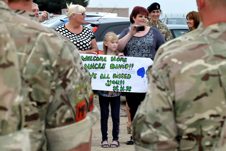 Family members and friends welcome soldiers