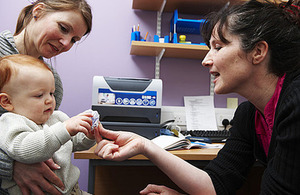 Mum with a baby having a health check up