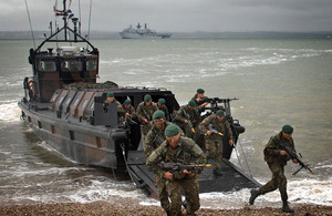 Young Royal Marines Commando Officers in training conducting a beach insertion exercise (library image) [Picture: Leading Airman (Photographer) Martin Carney, Crown Copyright/MOD 2012]