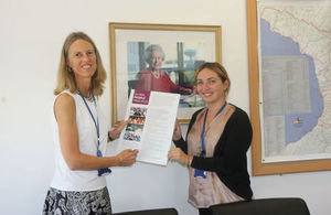 Ambassador Alexandra Hall Hall and Corporate Services Manager Tamuna Jaiani demonstrating Global Minimum Standards Poster