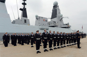 Members of HMS Duncan's ship's company line up on the dockside at the ship's commissioning ceremony [Picture: Leading Airman (Photographer) Maxine Davies, Crown copyright]