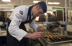 Senior Aircraftman Duncan Perry preparing dessert in the Parade Du Chef competition on RAF Day [Picture: Andrew Linnett, Crown copyright]