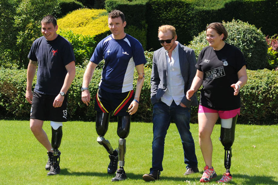 From left: Bombardier Paul Brent, Corporal Matt Webb, actor Simon Pegg and Captain Anna Poole in the grounds of Headley Court