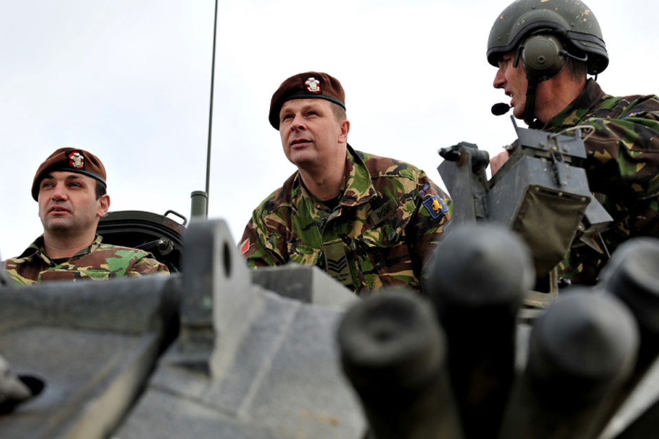 Territorial Army soldiers of the Royal Wessex Yeomanry take aim with a Challenger 2 main battle tank