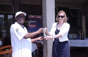 Ambassador Bronnert hands over the Legacy Trophy to St Giles School