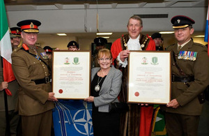 Lieutenant General James Bucknall (left) and Lieutenant Colonel Simon Butt (right) with the Mayor of Tewkesbury Borough, Councillor Philip Surman, and Deputy Mayor Councillor Claire Wright