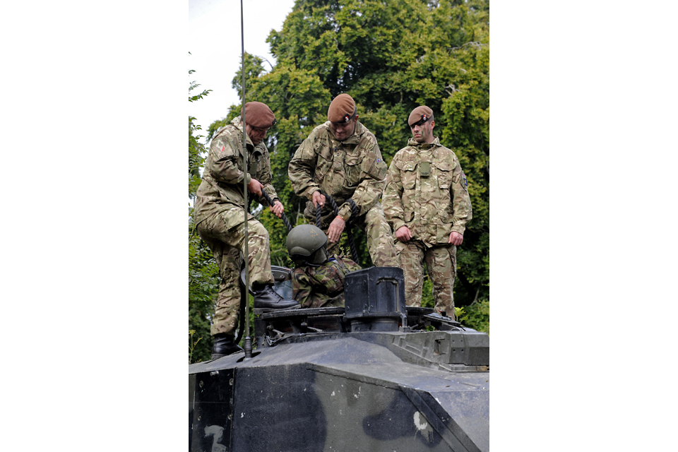 Troops work on extracting a casualty from a tank