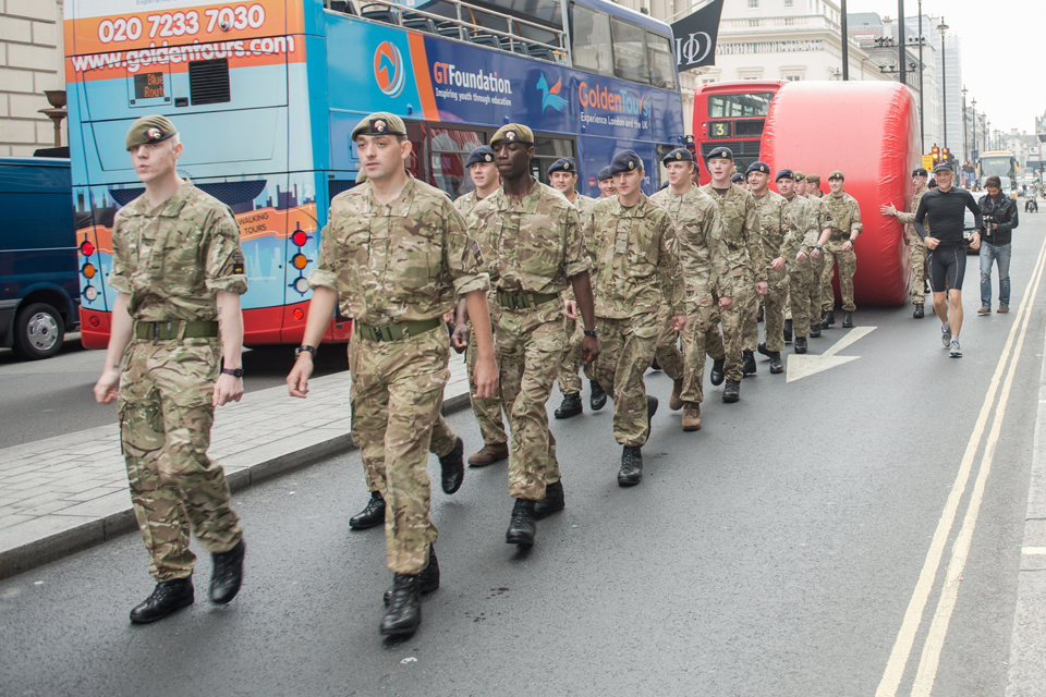 Soldiers bring the 'Stop' disk through central London