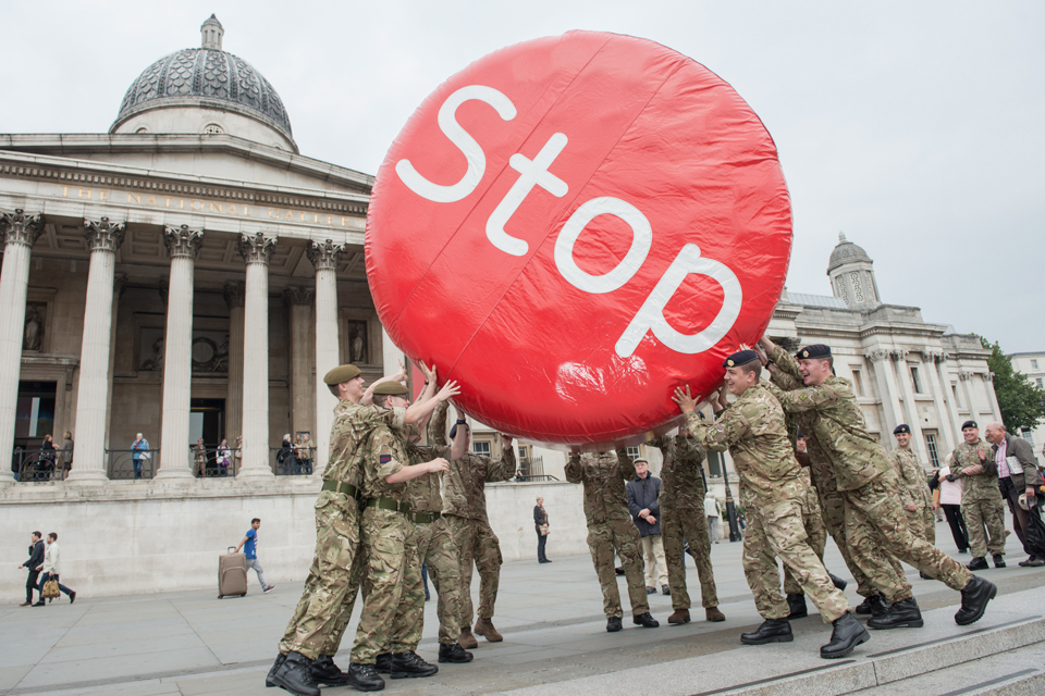 Soldiers with the 'Stop' disk in Trafalgar Square
