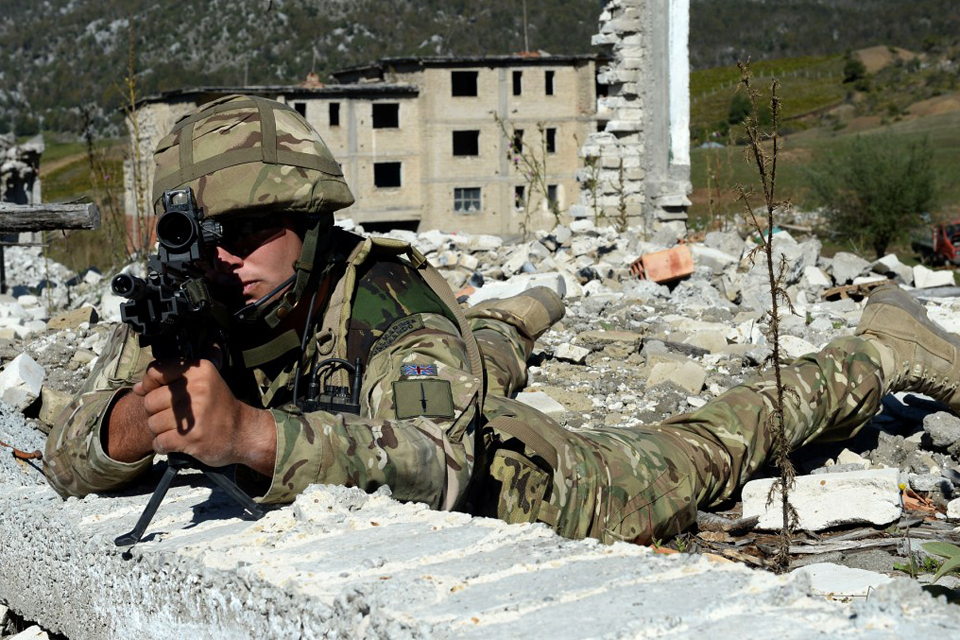 A Royal Marine looks through his rifle scope