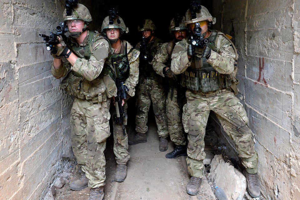Royal Marines emerge from a tunnel