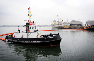 A boom is deployed, simulating the prevention of oil leaking into Plymouth Sound
