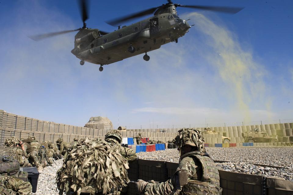 Royal Marines wait to board an RAF Chinook