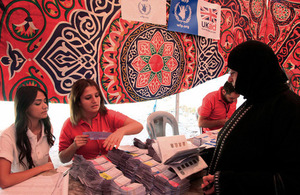 A Syrian refugee woman receives UK-funded food vouchers from WFP in Amman Jordan. Picture: Russell Watkins/DFID