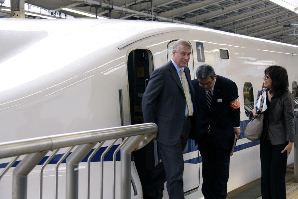 His Royal Highness The Duke of York exits the cockpit of a bullet train at JR Central's Tokyo Station