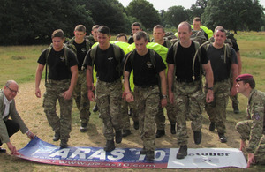 Stephen Cooper, Director of the Parachute Regiment Charity (left), and Captain Dominic Burn (right) at the start of a test run by 2 PARA soldiers around the Colchester PARAS' 10 course