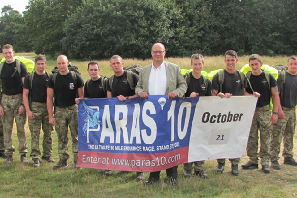 Stephen Cooper, Director of the Parachute Regiment Charity (centre), with 2 PARA soldiers before they start a test run around the Colchester PARAS' 10 course
