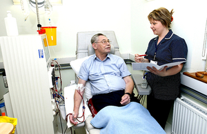 Man getting dialysis with nurse