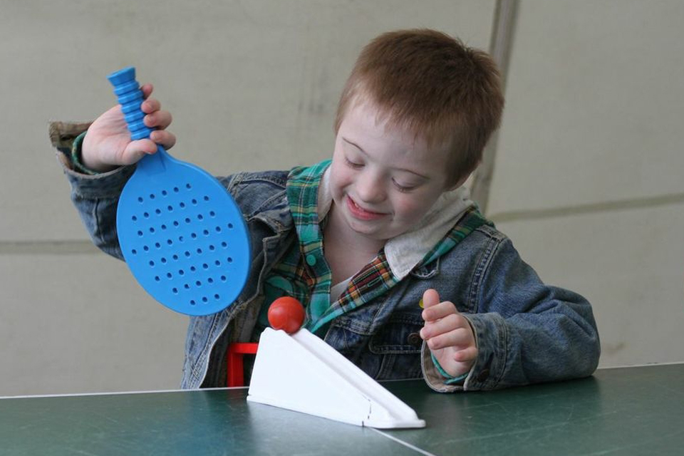 A child about to serve in table tennis
