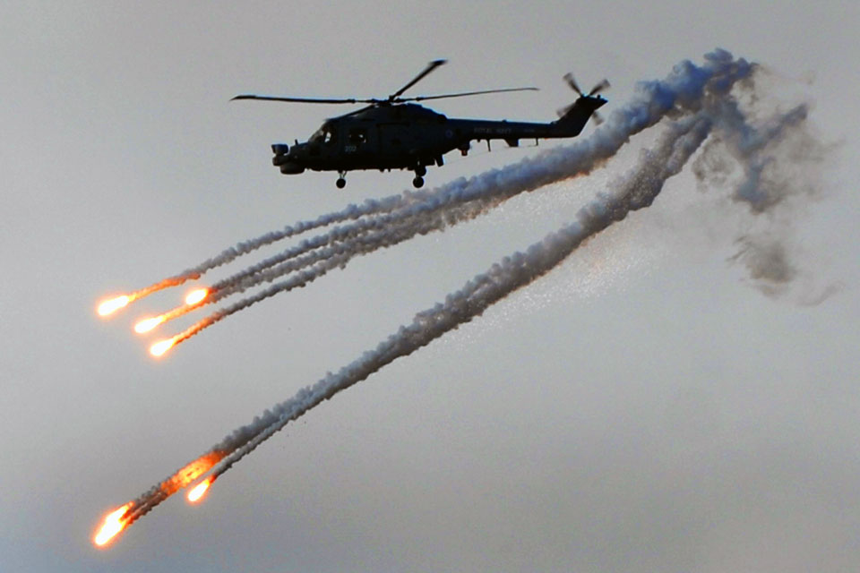 A Lynx helicopter deploys counter-heat-seeking-missile flares