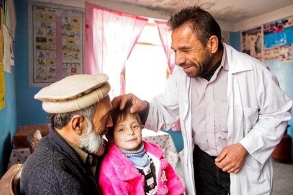 A doctor with one older and one younger patient