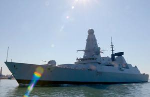 HMS Defender sails into Portsmouth