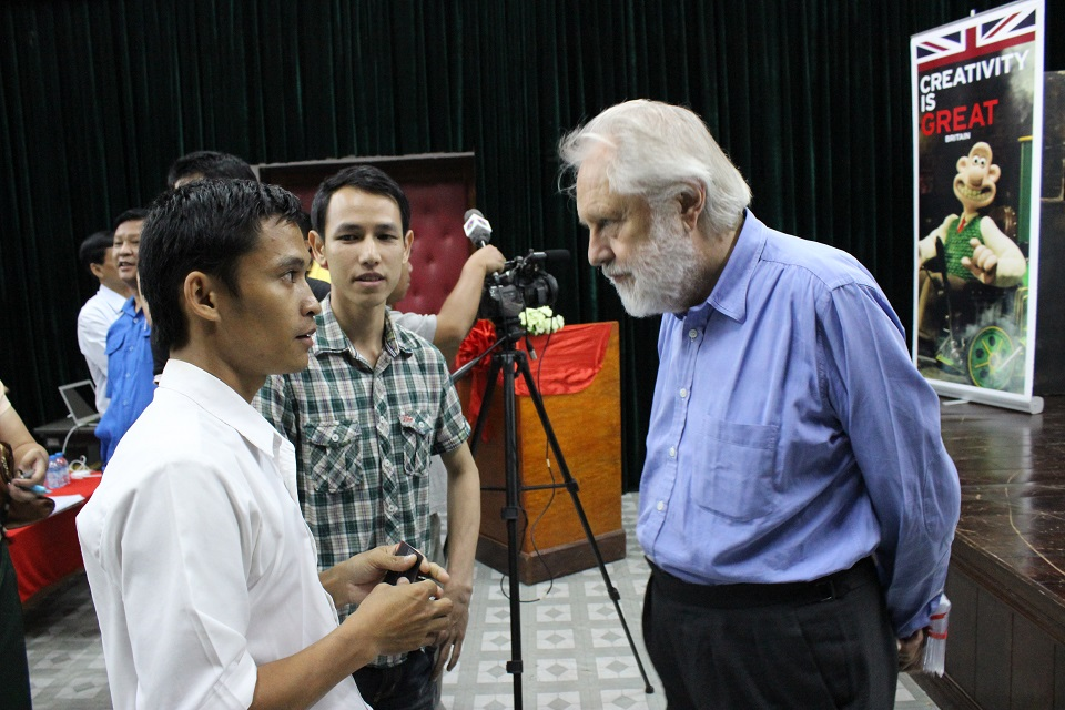 Lord Puttnam with young Lao filmmakers
